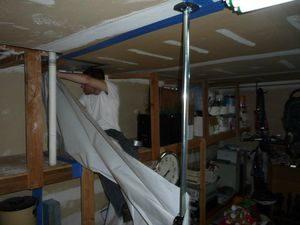 disaster-restoration-technician-removing-vapor-barrier