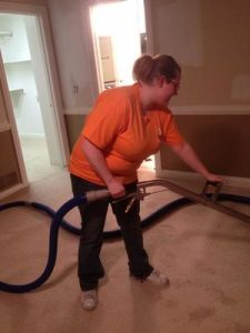 water-damage-restoration-plano-technician-vacuuming-up-water