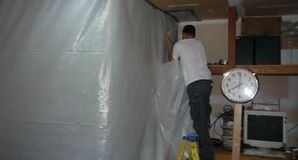 Water Damage Tech Sealing In Mold With Vapor Barrier